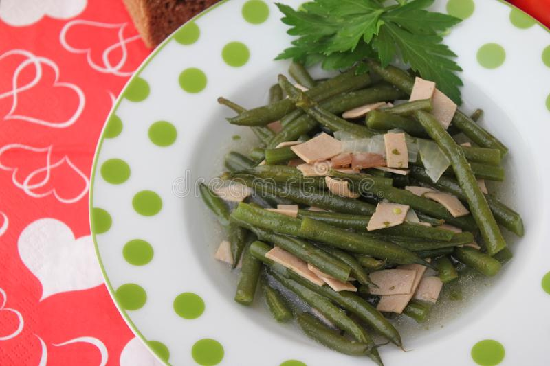 Green Beans. Some cooked green beans with pork sausage stock photography