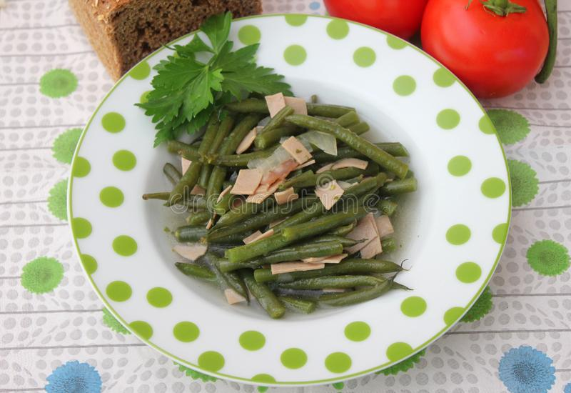 Green Beans. Some cooked green beans with pork sausage stock photo
