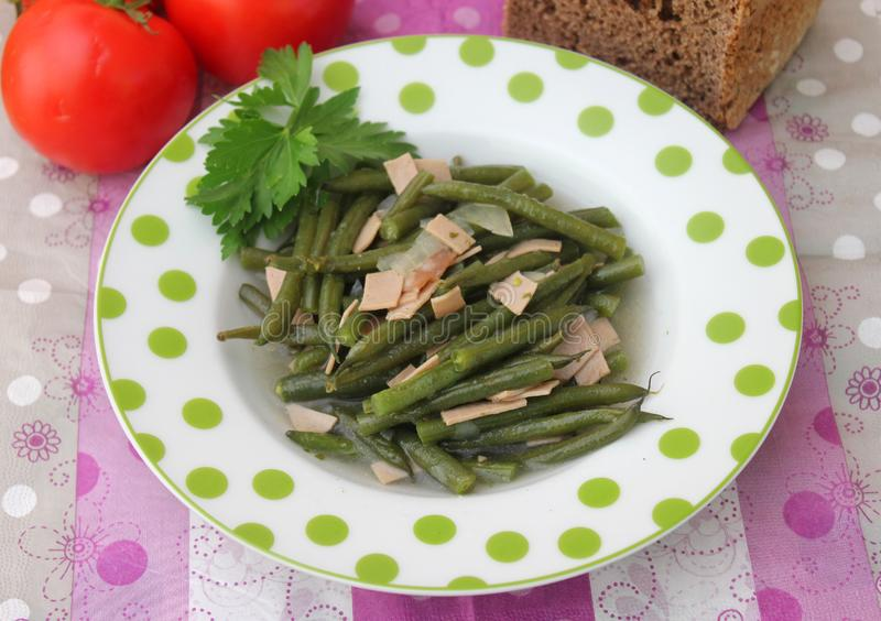 Green Beans. Some cooked green beans with pork sausage stock photos