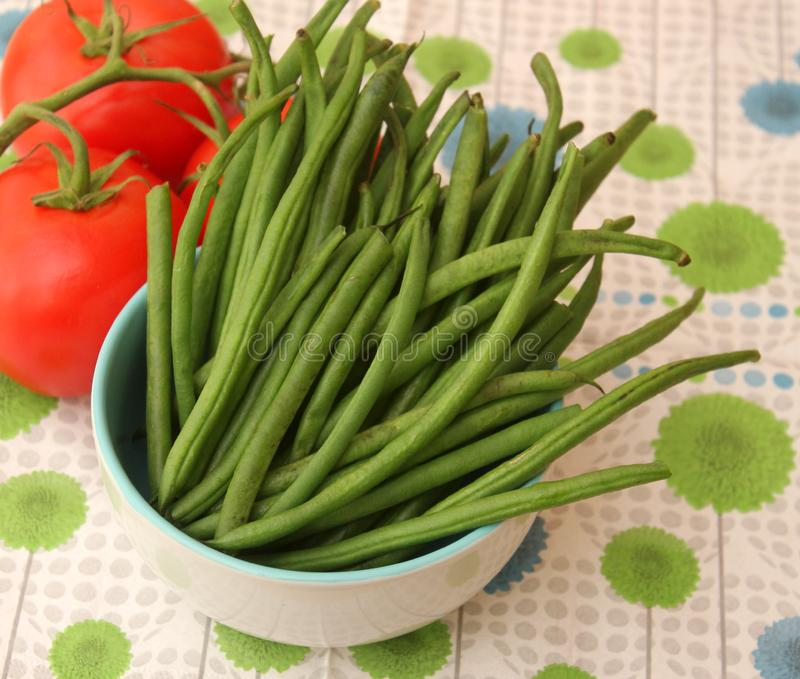 Green Beans. Some raw green beans in a bowl stock photography