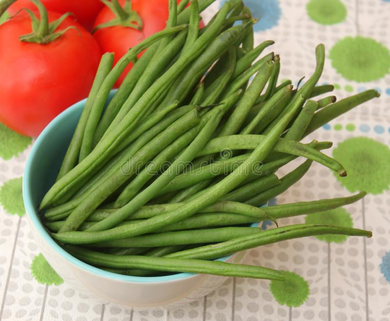 Green Beans. Some raw green beans in a bowl royalty free stock image