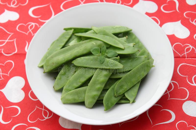 Green Beans. Some raw green beans in a bowl stock photos