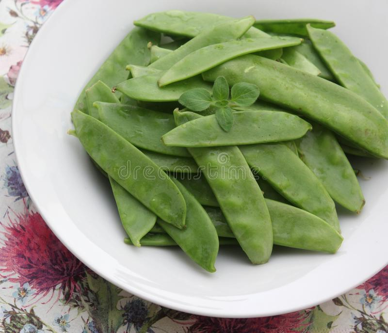 Green Beans. Some raw green beans in a bowl stock photo