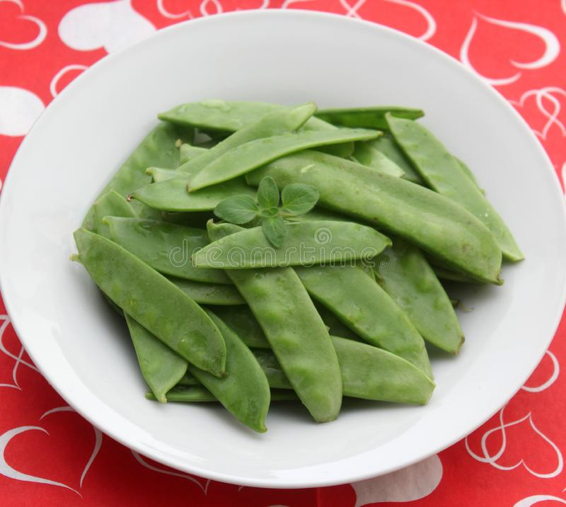 Green Beans. Some raw green beans in a bowl stock images
