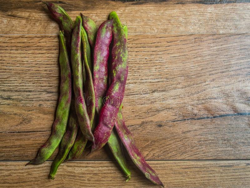 Green beans. On wood background royalty free stock photography
