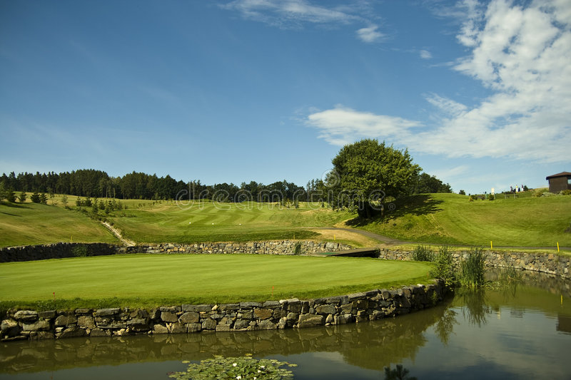 Green of a beautiful golf course royalty free stock photo