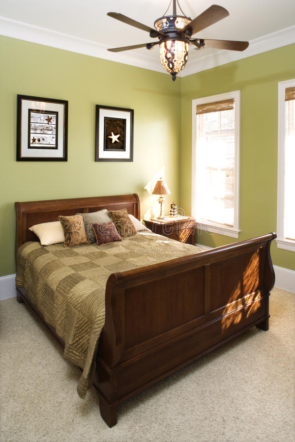 Green Bedroom With Ceiling Fan royalty free stock photography