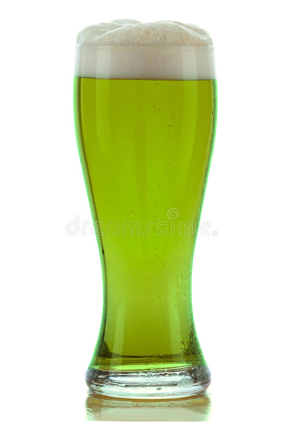 Green Beer. A cold frothy glass of green beer for St. Patricks Day isolated on white with a slight reflection royalty free stock photography