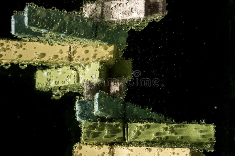 Green and Beige Clothes Clip on Water With Bubble Effect royalty free stock image