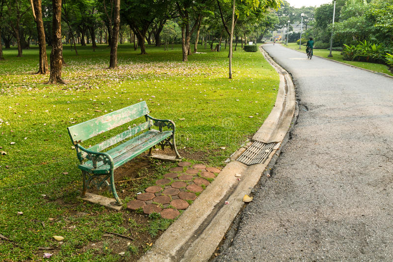 Green bench in the park. And streets royalty free stock images