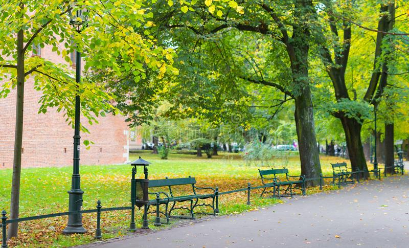 Green benches in the park against the background of the castle royalty free stock photo
