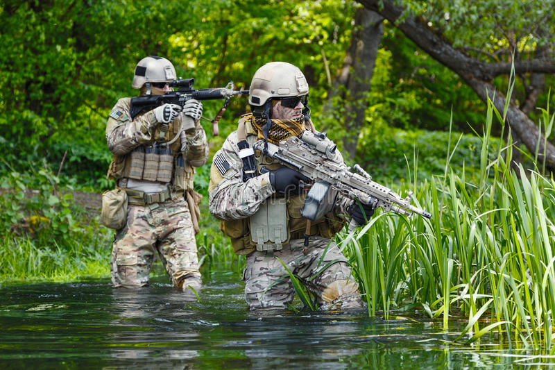 Green Berets soldiers in action stock photography