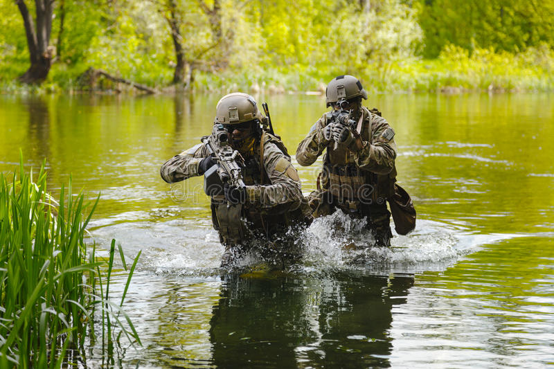 Green Berets soldiers in action stock photos