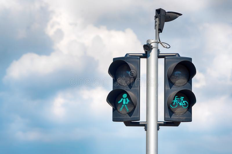 Green bicycle and pedestrian traffic lights. Green traffic light for bikes, gives cyclists priority, pedestrians royalty free stock photography