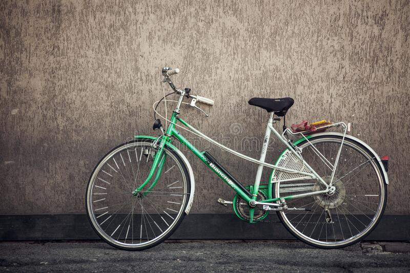 Green bike leaning against wall royalty free stock images