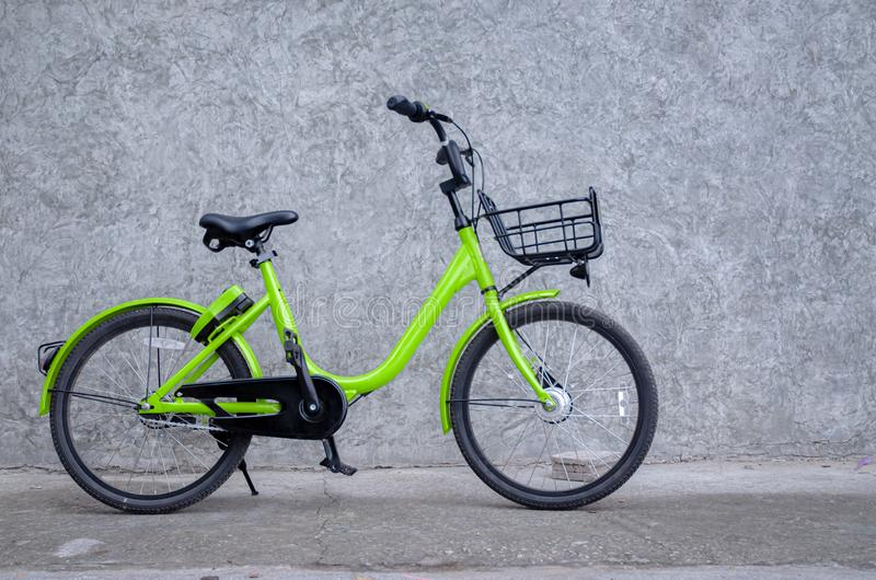 1 green bike. Parked beside the wall royalty free stock photo