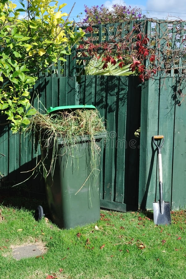 Download Green Bin And Spade In Backyard Stock Photo - Image: 19122936