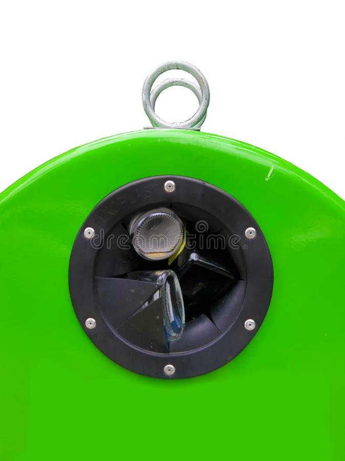 Green bin used for recycling glass isolated on a white background. Glass bottle coming out of a large glass recycling container royalty free stock photos