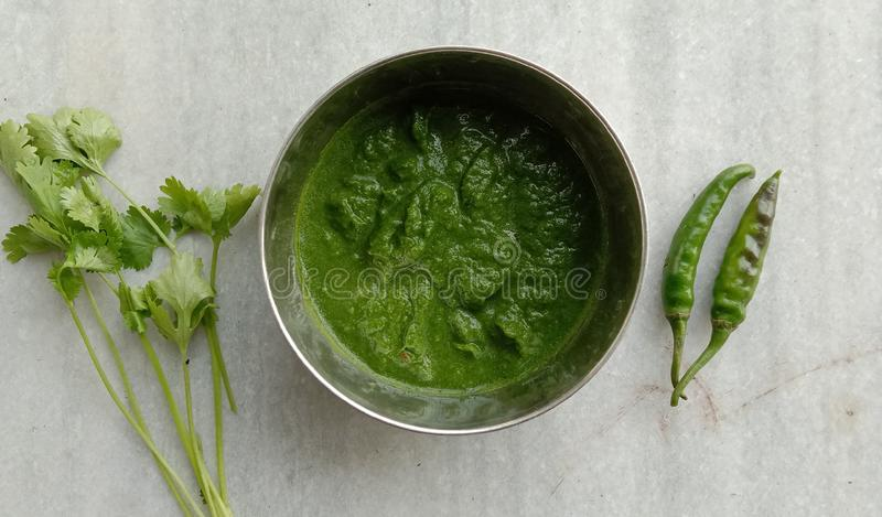 Coriander pickel with green chilli looks awesome on white dash board royalty free stock photography
