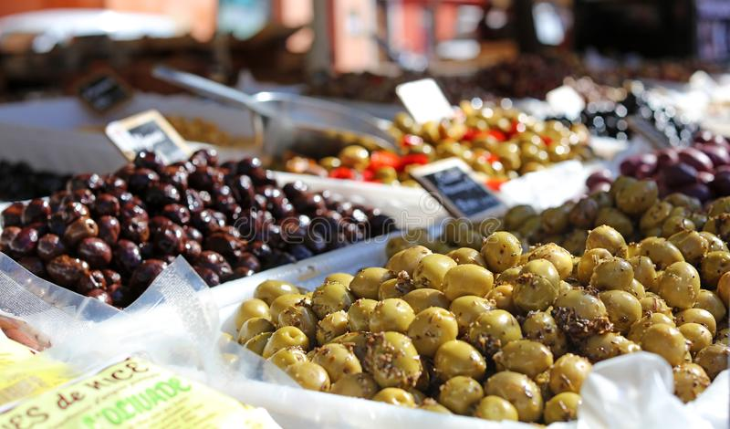 Green and black olives at a farmer market in France, Europe. Italian olive. Street French market at Nice. Fresh food by local farmers royalty free stock image