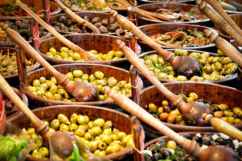 Green and black olives on a market royalty free stock photo
