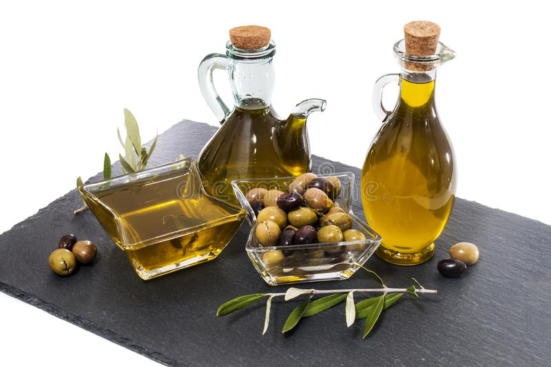 Green and black olives with olive oil bottles. Isolated on a white background royalty free stock photos