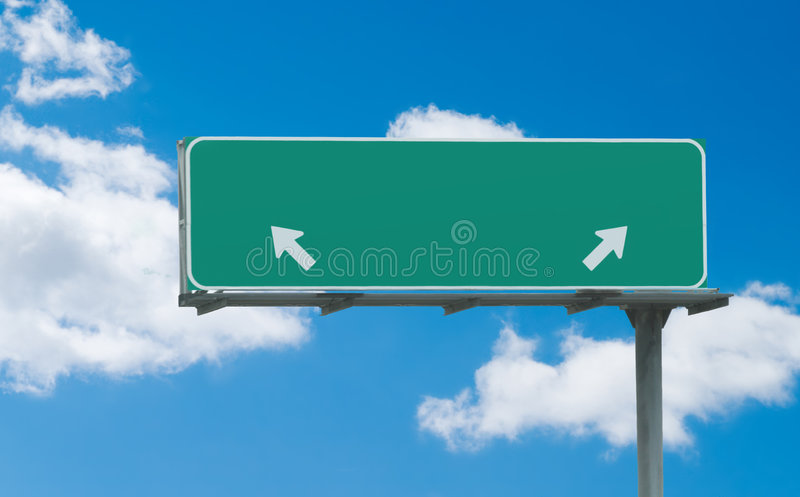 Green blank freeway sign. Typical green freeway sign with two arrows pointing in opposite directions ready for custom text stock photography