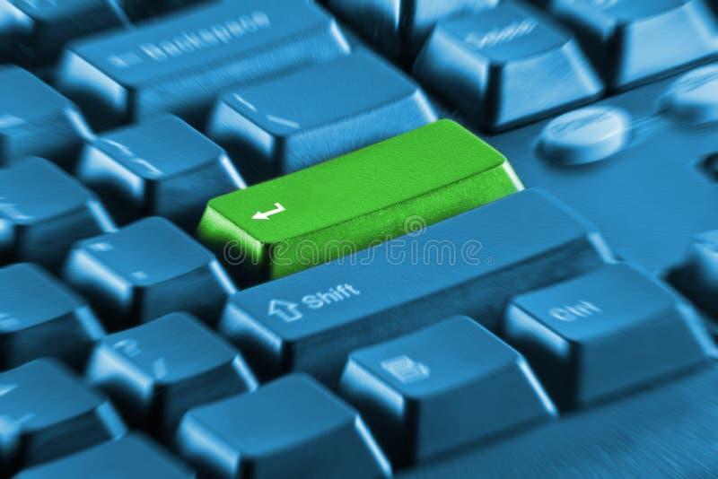 Green blank key on computer keyboard stock photography