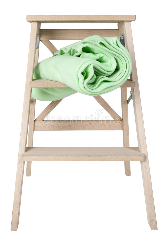 Green blanket on a stepladder isolated on white background stock photo