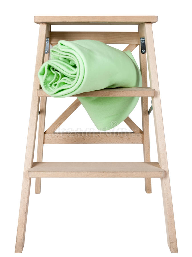 Green blanket on a stepladder isolated on white background royalty free stock image