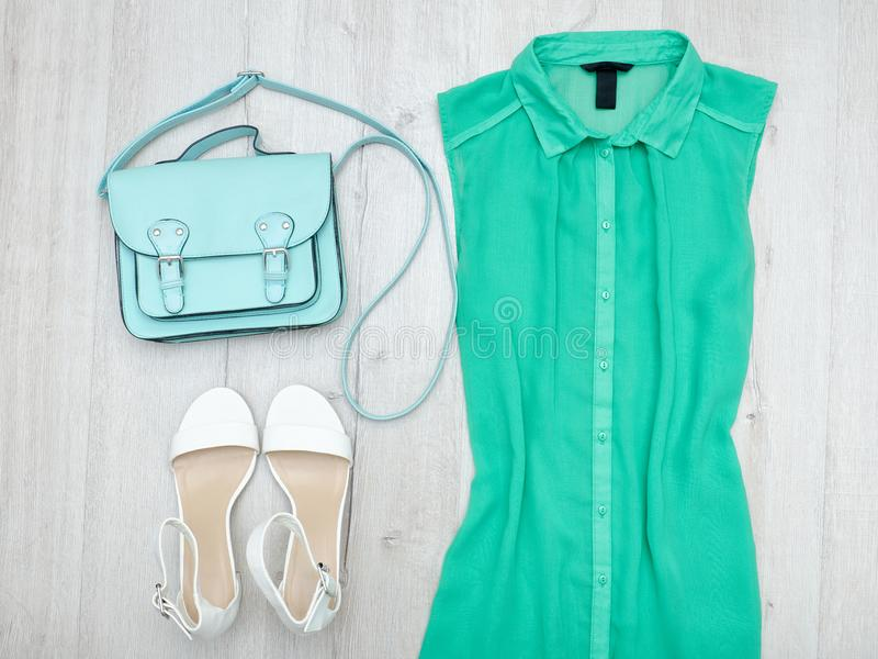 Green blouse, white shoes and mint bag. Fashionable concept. Green blouse, white shoes and mint bag. Fashionable concept royalty free stock photo