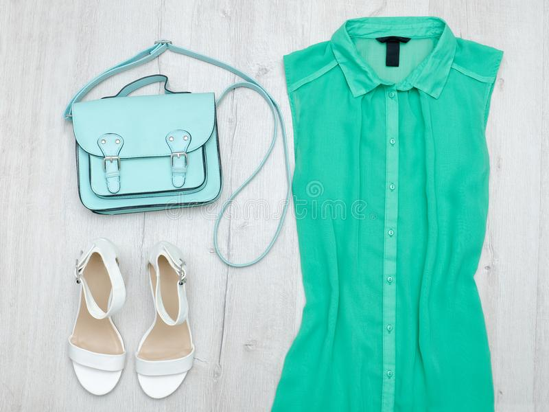 Green blouse, white shoes and mint bag. Fashionable concept. Green blouse, white shoes and mint bag. Fashionable concept royalty free stock photos