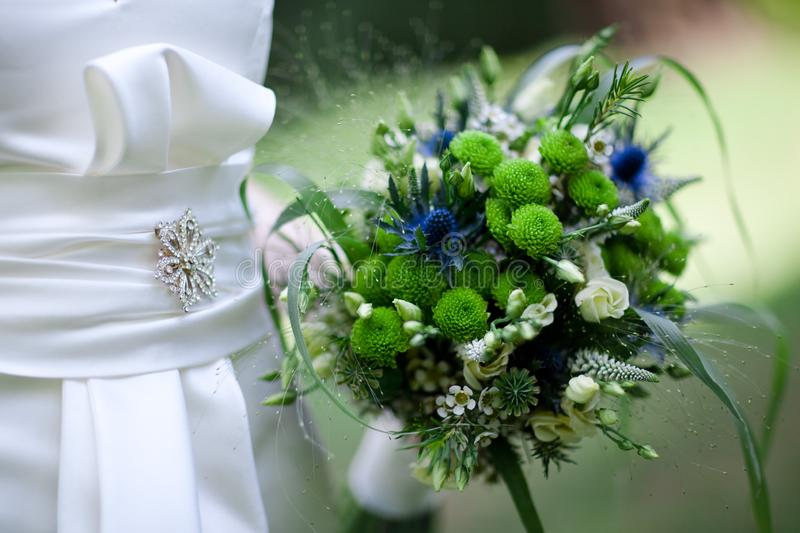Green blue bouquet - Wedding in summer. Green blue bouquet. Wedding in summer. Shallow focus. Suits white and creamy wedding gress royalty free stock image