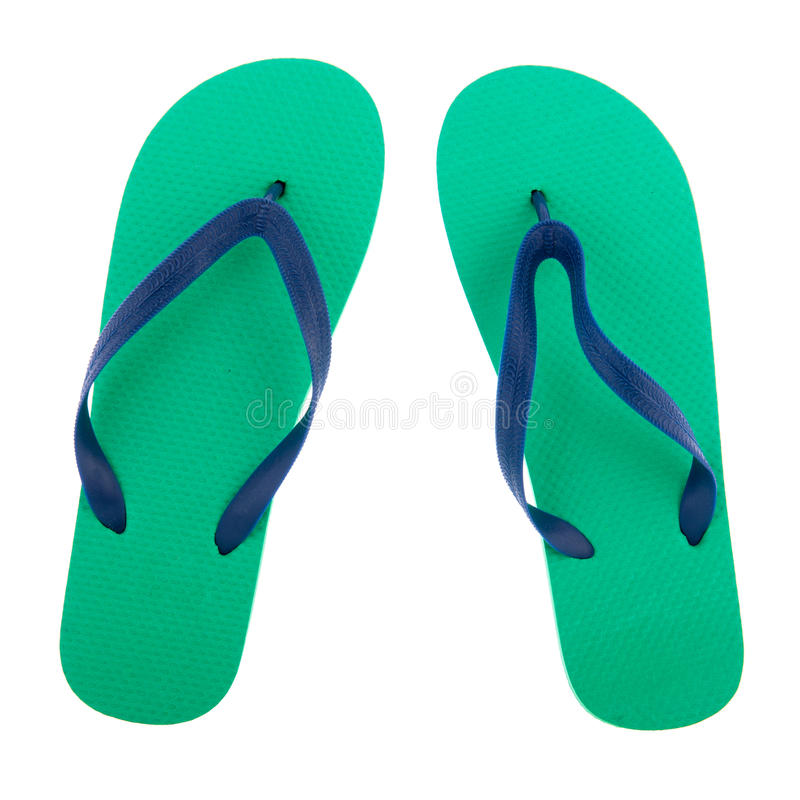 Green and blue flip flops. Isolated over white background royalty free stock images