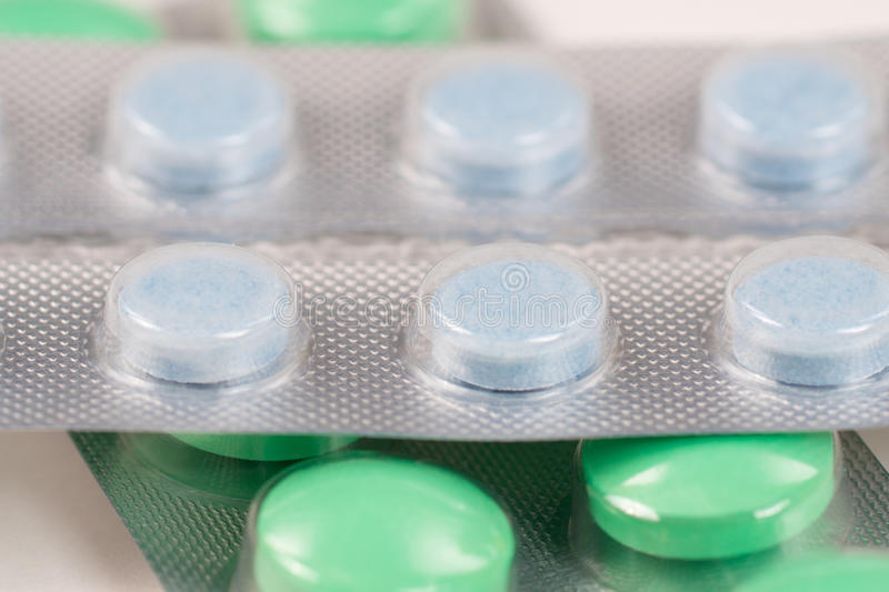 Green and blue pills royalty free stock images