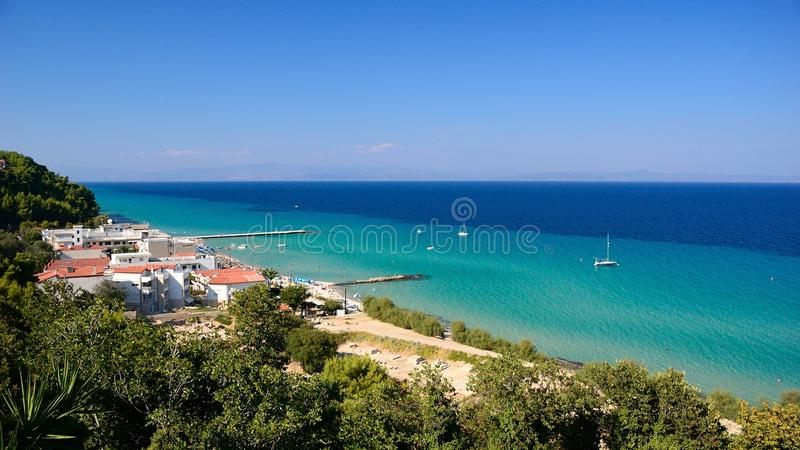 Green and blue sea water in summer time. Green and blue seaside water in summer time - sunny day on the beach royalty free stock image