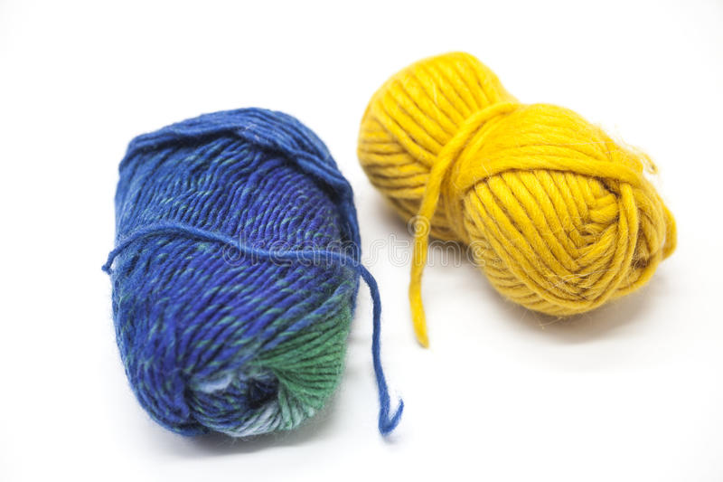 Green blue and yellow ball of wool yarn for knitting close up on a white background royalty free stock images