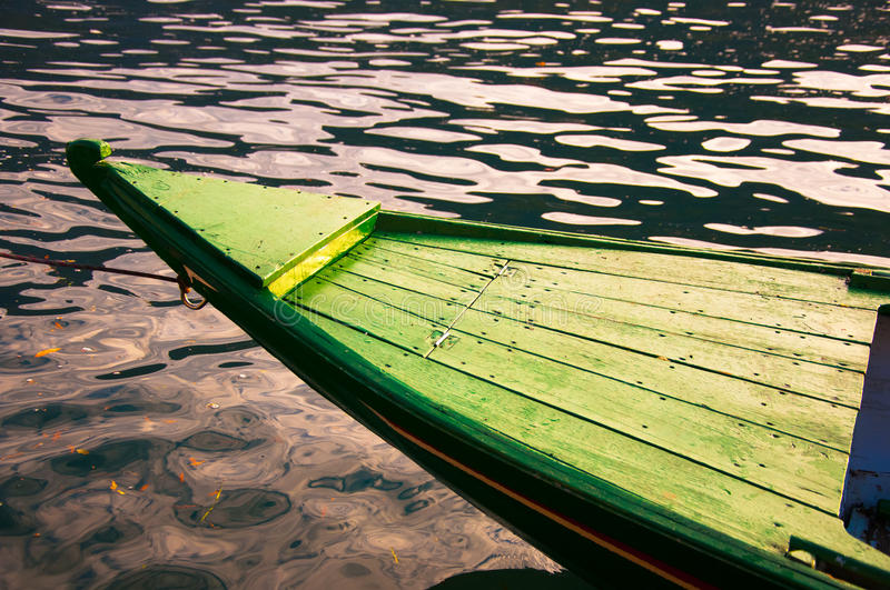 Green boat. On the lake royalty free stock images