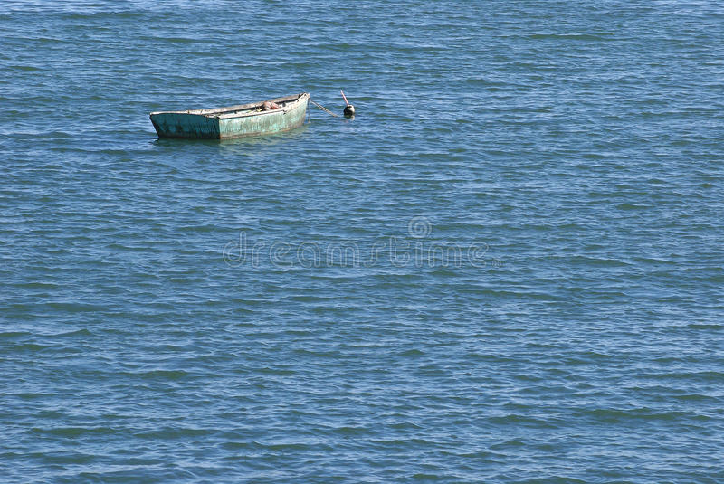 Green Boat Blue Water royalty free stock image