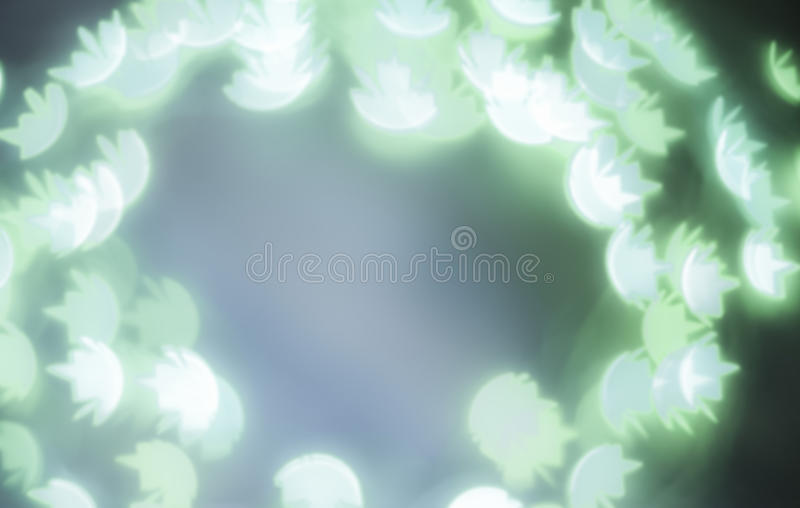 Green bokeh lights in water lily shape stock image