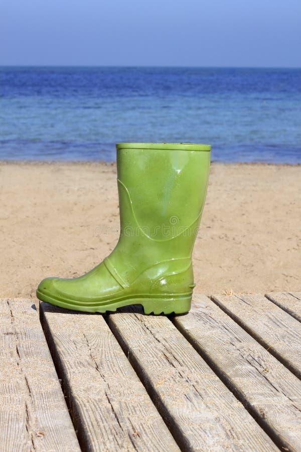 Download Green Boot On Beach Unlucky Fisherman Metaphor Stock Photo - Image: 14885416