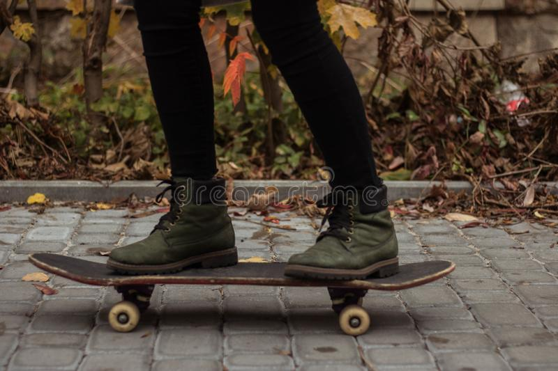 Green boots on a skateboard royalty free stock photos