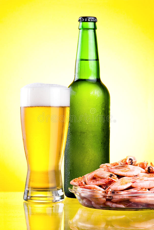 Green bottle of beer with a condensate stock images