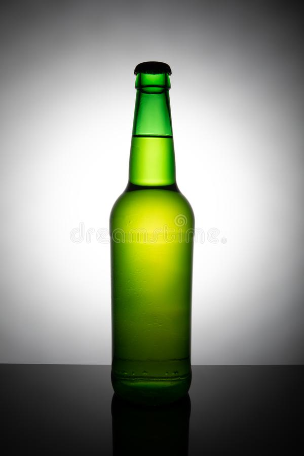 Green bottle of beer isolated on white background. Alcohol, beverage, bubble, cap, celebration, clear, closeup, cold, condensation, cool, design, drink, drop royalty free stock photo