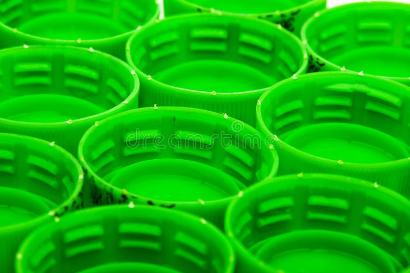 Green bottle caps. Group of green bottle caps, abstract photo royalty free stock images