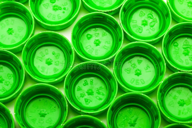 Green bottle caps. Group of green bottle caps, abstract photo stock images