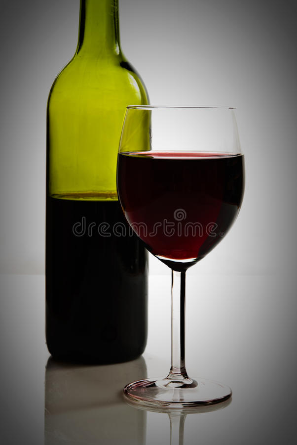 Green Bottle And Glass Of Red Wine Stock Images