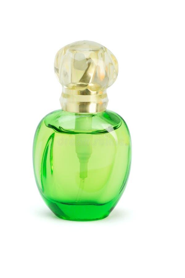 Green bottle of perfume royalty free stock photo