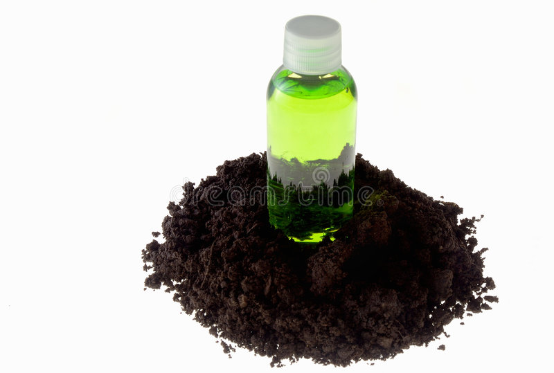 Green bottle and soil stock image