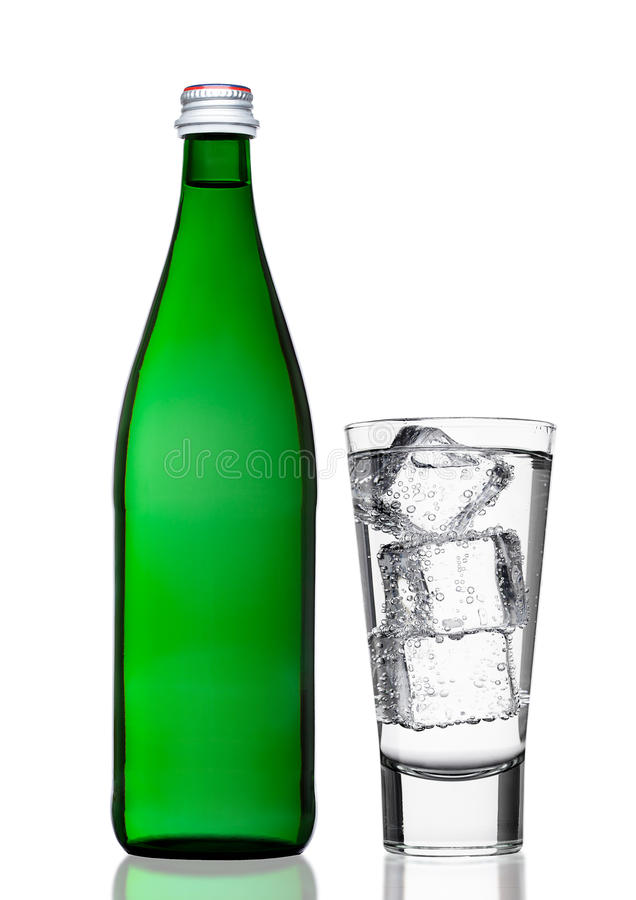 Green bottle of sparkling mineral water with glass royalty free stock photos